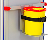 Can of consumables tied with a black strap to a metal support to be placed on an accessory holder bar