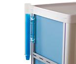 Set of blue cups inside a plastic dispenser on the side of a medication cart
